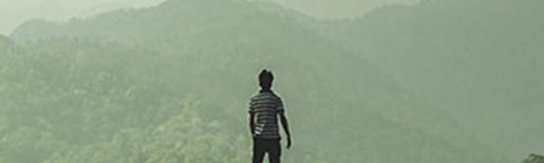 person-top-cloudy-mountain-cta-box-banner.jpg